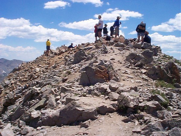 Crowds on the summit of Huron Peak (14,005 feet) around noon.  No thunderstorms in sight!