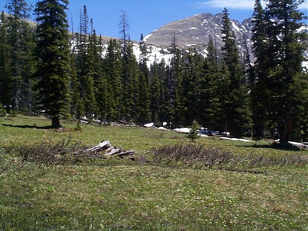 The snow covered hillside leading up to Arapaho Pass.