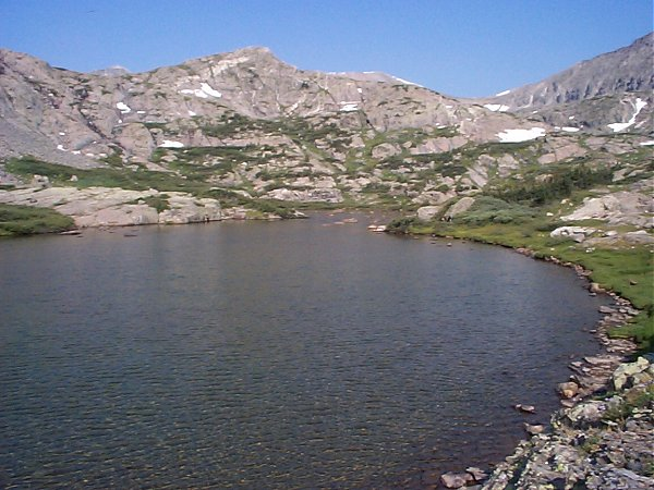 A short distance above the waterfalls you arrive at the first of several high mountain lakes.  This one sits at about 11,900 feet.
