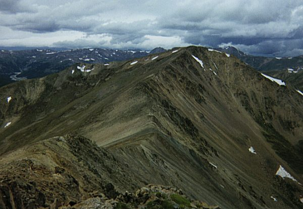 The ridge (left center) to the summit of Mount Parnassus as seen from Bard Peak.