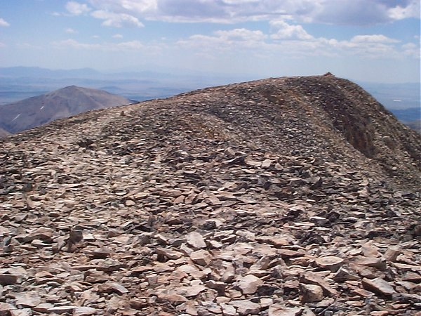 Although I had already walked past this, the actual summit of Mount Sheridan (13,748 feet), here's what it looks like when facing east with South Park as the background.