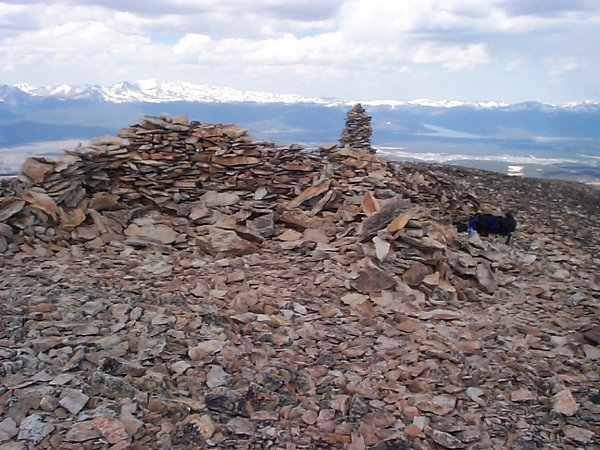 Only a few feet lower than the actual summit, on the west side of the top of the mountain there exists stone structure which I used to block the wind.