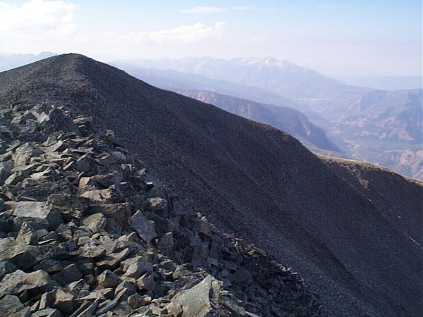 Looking back on the summit of West Mount Sopris with Chair Mountain on the horizon.