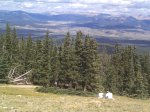 A father and son enjoying the view with Leadville below.