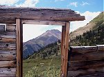Winfield Peak (13,077 feet) as seen through the ruins of an old mining shack (looking south-southeast).