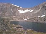 As there is no longer a trail to follow, a route to the top was chosen by going around the south side of this lake (12,695 feet) and up through the dry spot in the snow covered saddle.