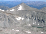 That is Pacific Peak just to the northwest.  Notice the small, unnamed lake just below its' summit behind the ridge.  The unnamed lake prominent in this image sits at an elevation of 12,695 feet.